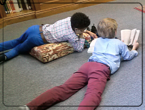 photograph of boys reading